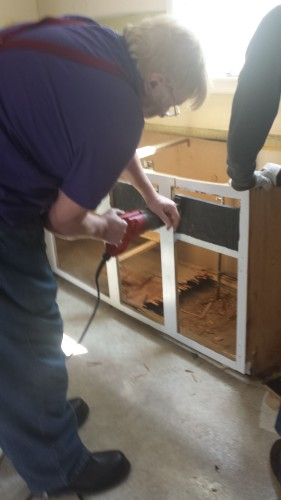My dad using a sawzall on one of the cabinets