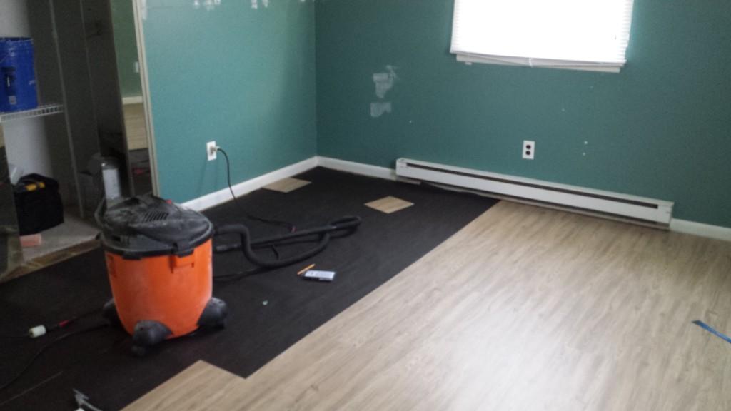 Flooring is half installed in the big bedroom
