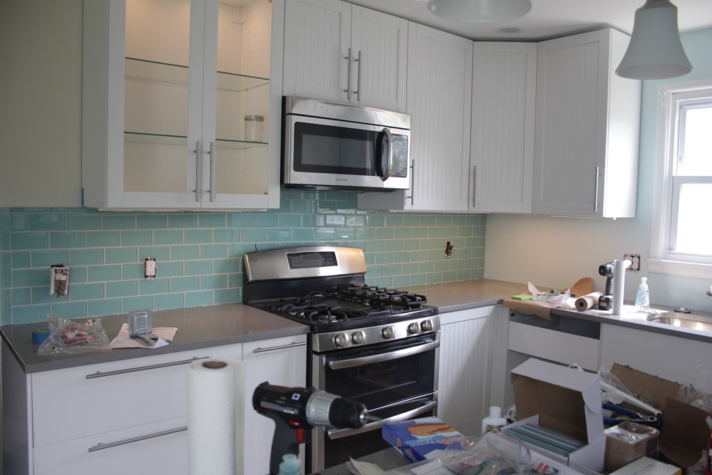 Kitchen, with half the backsplash and a working stove!