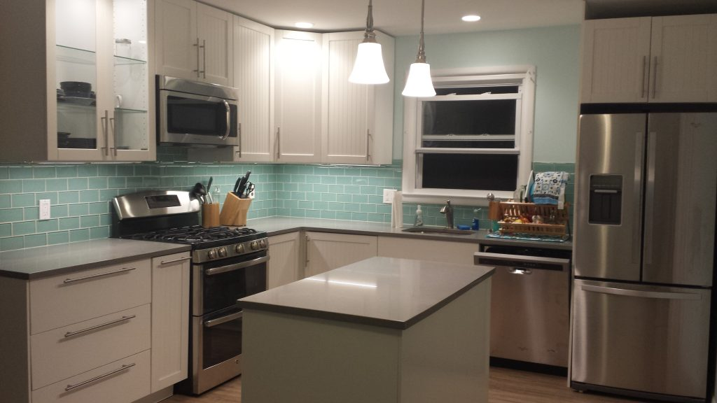 Finished kitchen with lights on