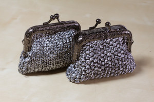 Coin purses. I've had this ball of ribbon yarn I never knew what to do with and finally settled on coin purses. 1 ball used.
