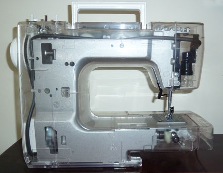 A Janome JR1012 in a clear plastic case so you can see the metal frame inside