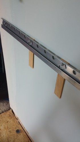 One Lower Rail With Shims Because The Wall Is Not Flat